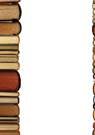 stacked books: A pile of old books as a colorful border isolated on white background with copy space area Stock Photo