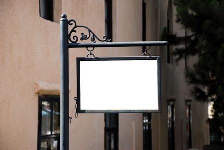 Blank white sign with a copy space area hanged from a pole Stock Photo - 8231940
