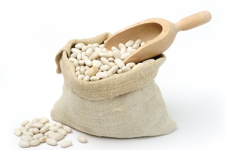An image of white beans a burlap sack