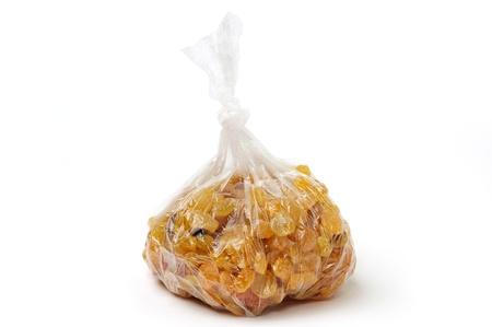 An image of tasty raisins in a clear bag
