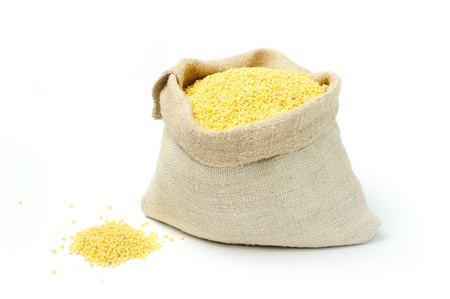 millet: An image of raw yellow millets in a burlap bag