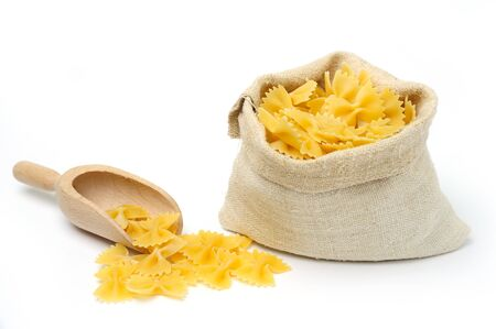 An image of raw pasta in a bag and a scoop Stock Photo
