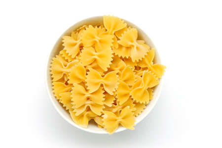 An image of a bowl of raw yellow macaroni Stock Photo