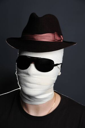 An image of man with bandage on her face
