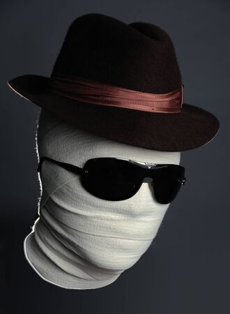 Portrait of The Invisible man in hat with black glasses on Stock Photo