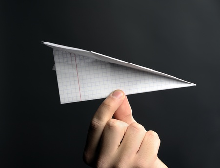 paper airplane: An image of paper airplane in hand