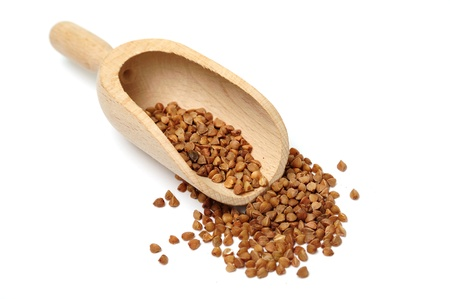 An image of buckwheat in a wooden scoop