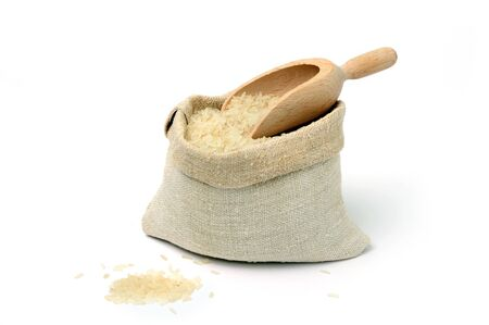 An image of raw rice in a burlap sack