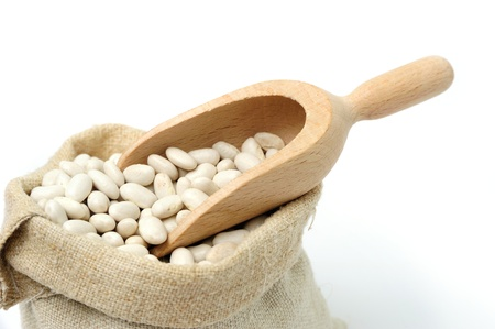 An image of white beans a textile sack