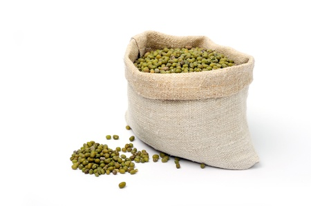 An image of green lentils in a sack