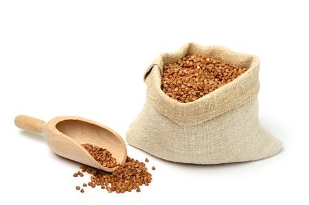 An image of raw buckwheat in a burlap sack Stock Photo