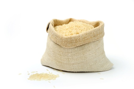 An image of raw rice in a textile sack Stock Photo