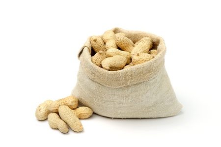 An image of peanuts in a textile sack Stock Photo