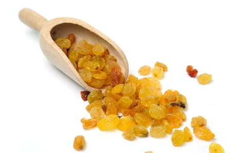 raisins: An image of raw yellow raisins in a wooden scoop Stock Photo