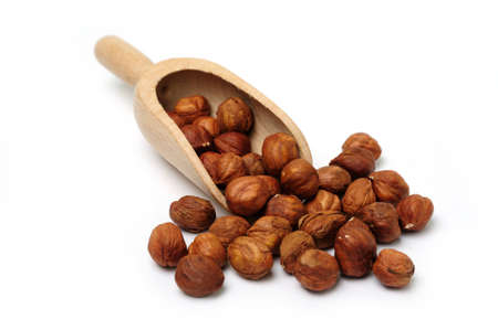 An image of cobnuts in a wooden scoop Stock Photo