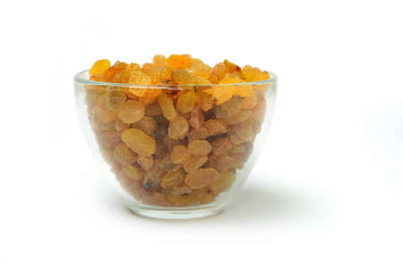 An image of  raisins in a transparent bowl Stock Photo
