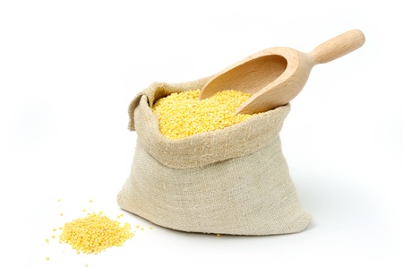 An image of raw yellow millets in a bag