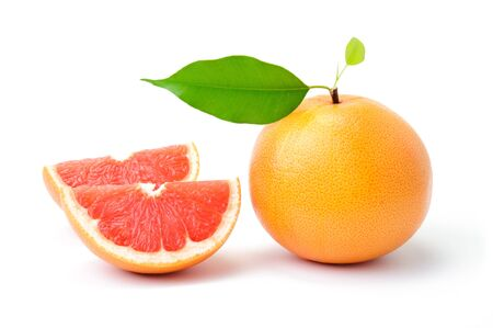 Ripe grapefruit with leaves and slices on white