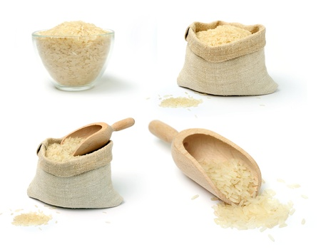 A srt of raw rice in a burlap sack and cup Stock Photo - 12605215