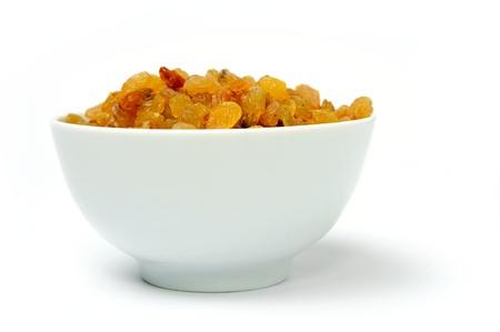 An image of raisins in bowl on white Stock Photo