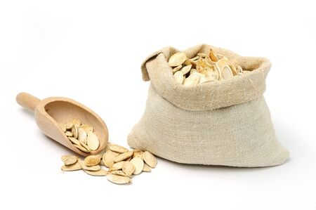 burlap sack: An image of dried pumpkin seeds in a sack