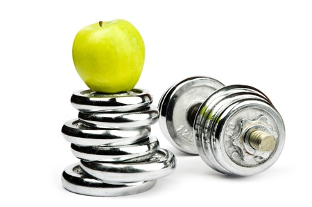 An image of silver dumbbells and an apple