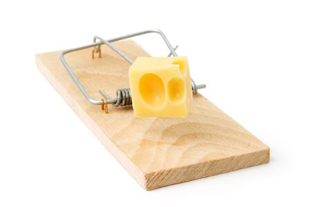Mousetrap with piece of cheese on white Stock Photo