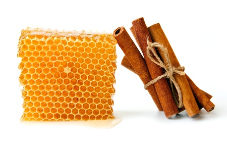 An image of honeycomb and sticks of cinnamon Stock Photo