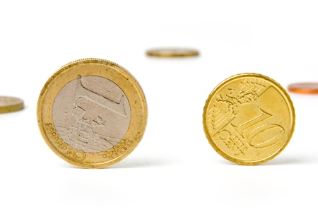 An image of shiny coins on white background