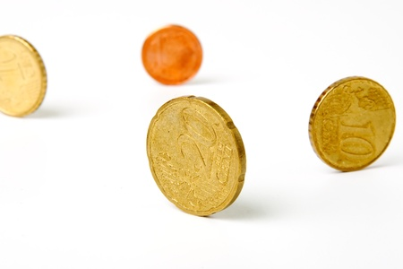 An image of yellow coins on white background Stock Photo - 17017443