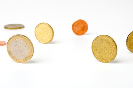An image of small coins on white background photo