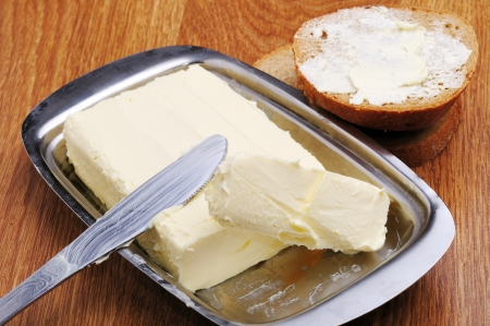 An image of yellow fresh butter on plate