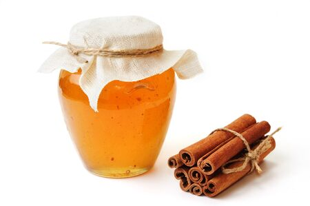 honey jar: An image of Sweet honey in jar with cinnamon on white background
