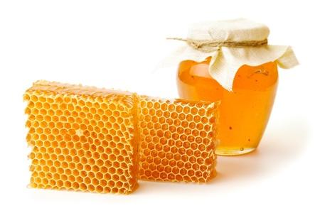 honey pot: jar of honey and  honeycombs on white background Stock Photo