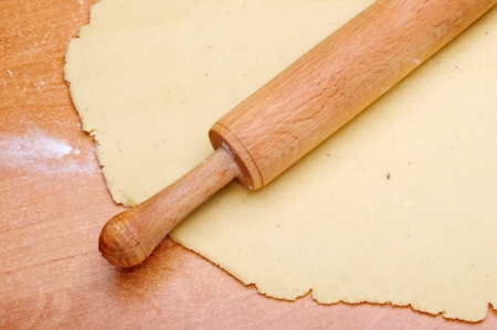 pastry: A wooden rolling pin on the dough