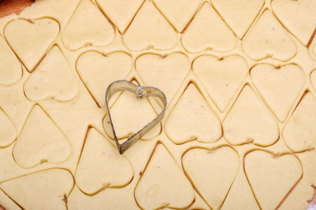 Tasty cookies in the shape of hearts on an oven-tray