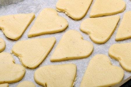 Cookies in the shape of hearts on an oven-tray Stock Photo