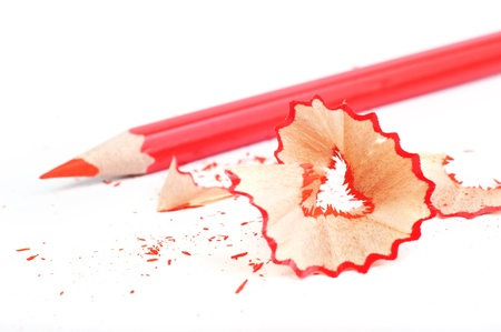 red pencil: Red pencil and wood shavings isolated on white