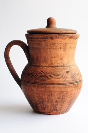 An image of �lay jug on the white background Stock Photo