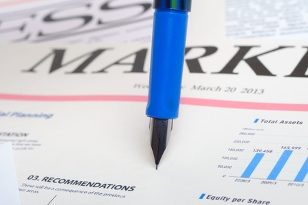 An image of pen on stock market graphics Stock Photo