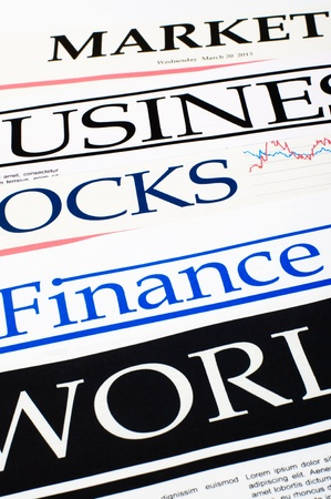 An image of titles of newspapers about the business close-up Stock Photo