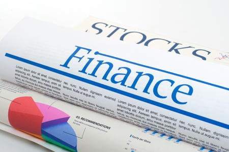 financial newspaper with stock market graphics
