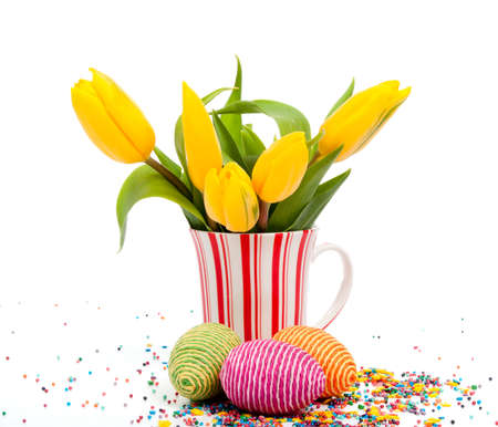 floral arrangements: Easter yellow tulips on cup with eggs