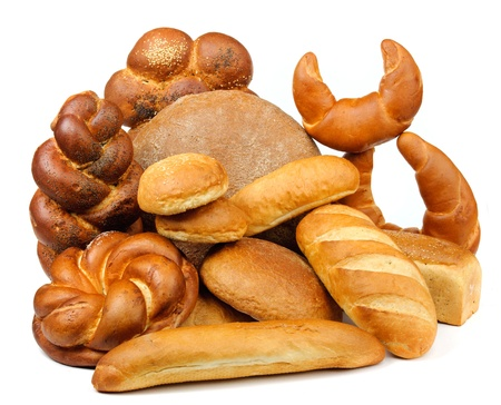 assortment of baked bread on white table