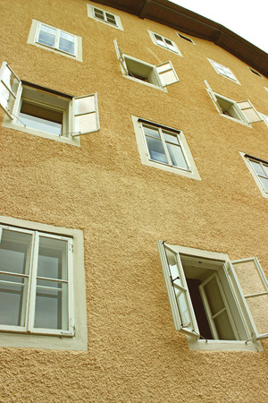 open windows: Open windows on a building, toned effect Stock Photo