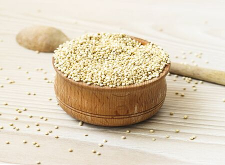 Quinoa seeds in a wooden bowl