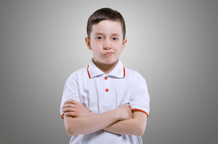 7 9 years: Grimacing face boy portrait 7 - 9 years Stock Photo