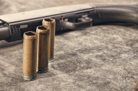 shotgun: Weapon. Shotgun concept. Black shotgun and shotgun sleeve.  Detail. Stock Photo