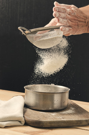 Bakery product. Tasty cooking for you. Cooking process. Flour and sieve. Stock Photo