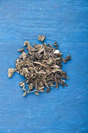 Highest class green tea on the blue background.